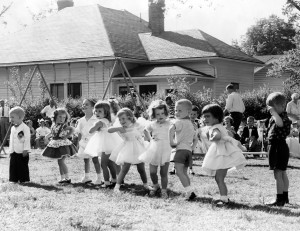 Ann Whitley and friends do the Hokey Pokey on May Day at Jack and Jill, High Point, NC ca. 1954